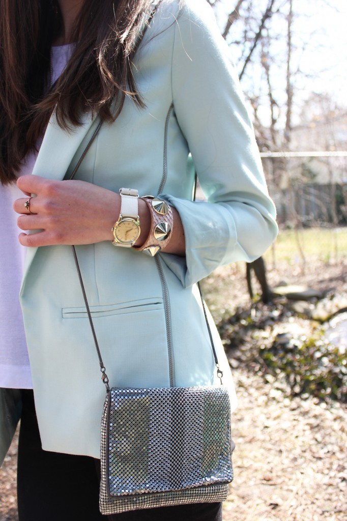 Style Bee in a blue blazer, black pants and silver purse