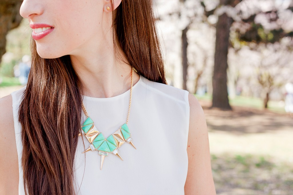 Style Bee in white with green and gold necklace