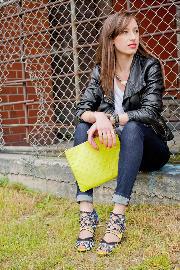 Style Bee in jeans, mixed material heels, a white tee and lime green clutch.