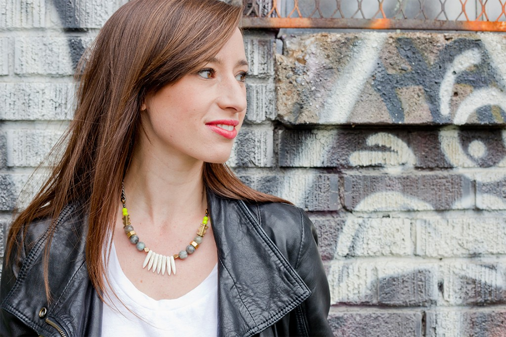 Style Bee in Biko necklace, leather jacket and white tee.