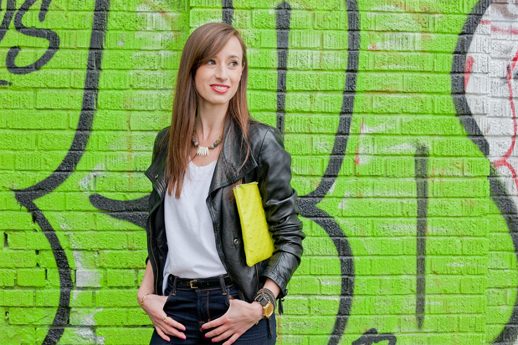 Style Bee in jeans, a white tee and lime green clutch.