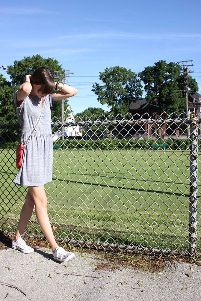 Style Bee in a grey dress, botkier bag and converse sneakers