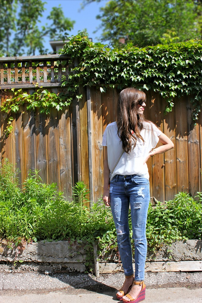 Style Bee in a white top, ripped jeans and Botkier bag and Coach platforms.