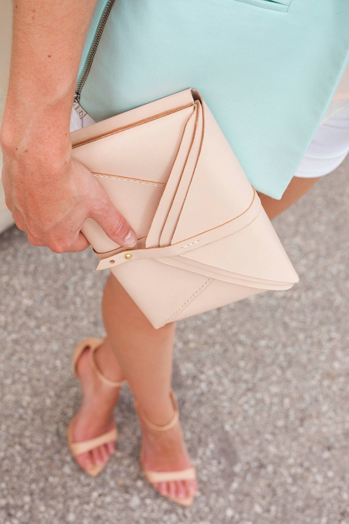 Style bee holding Boticca purse by Harlex.
