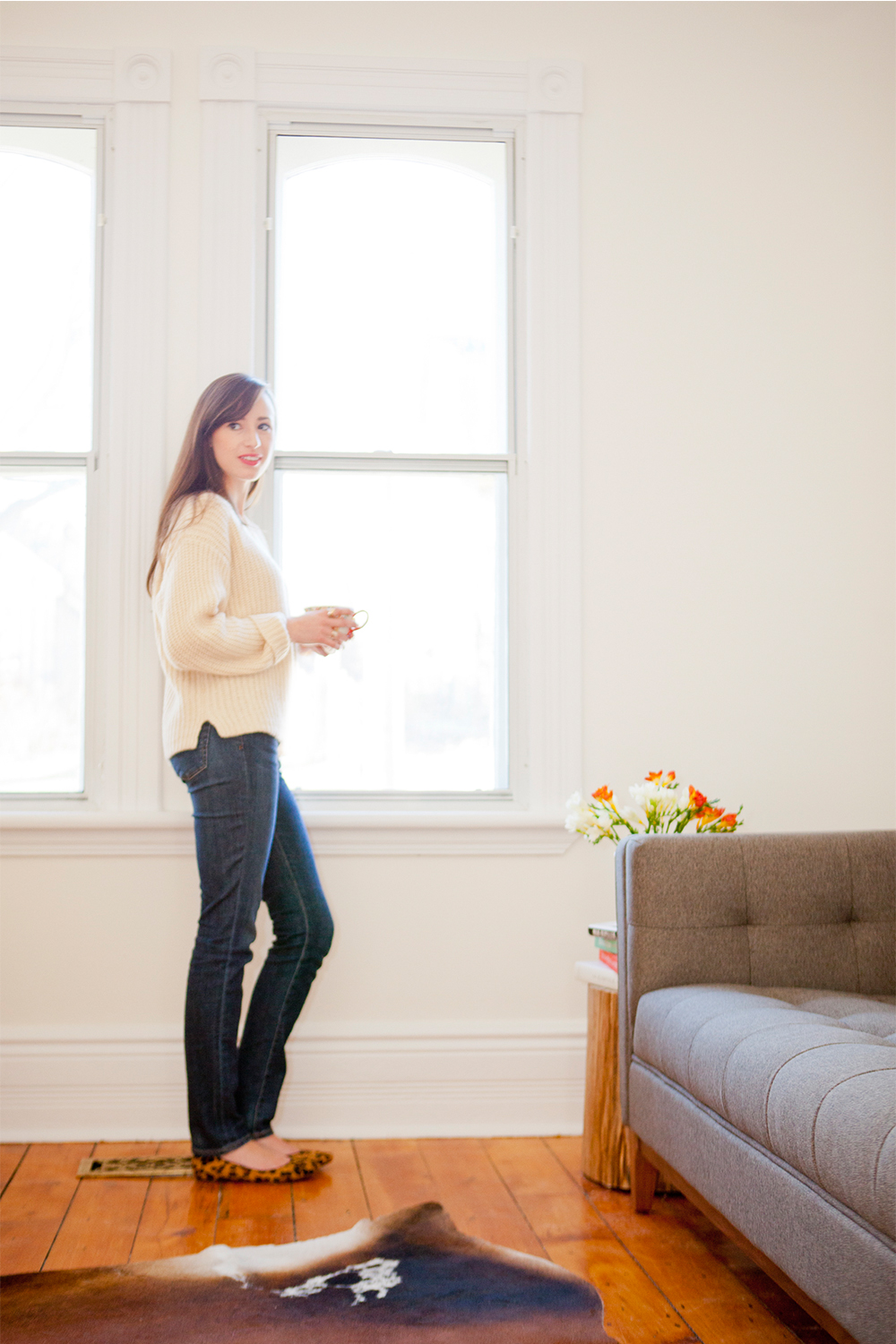 Style Bee at home in a Ganni sweater and AG denim.