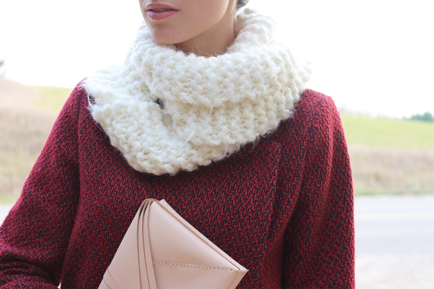 Style Bee in a red coat and infinity scarf.