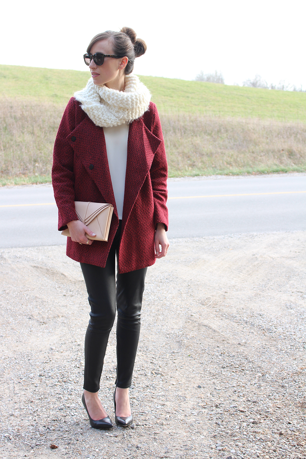 Style Bee in leather pants and red coat.