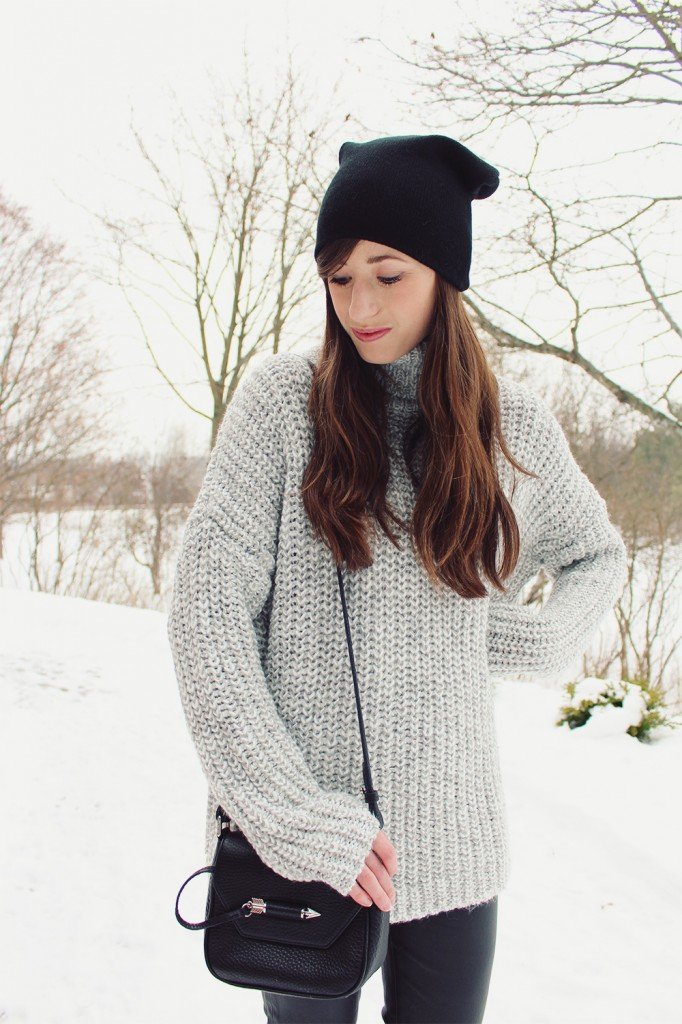 Style Be in a Grey sweater with a Mackage bag.