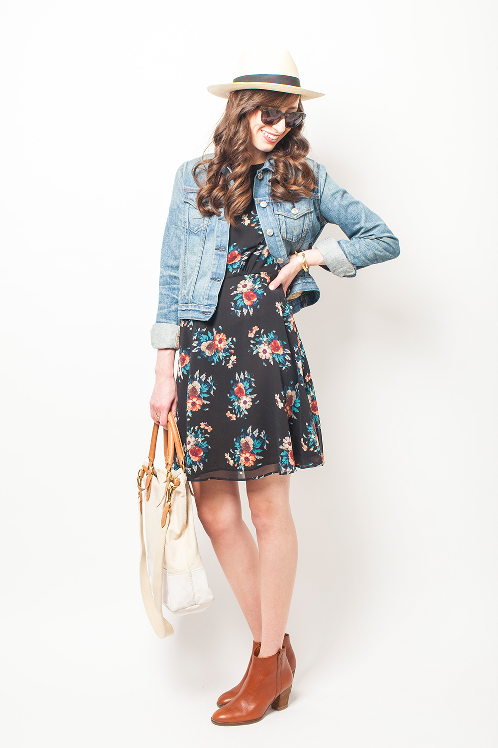 Style Bee in a floral dress and denim jacket.