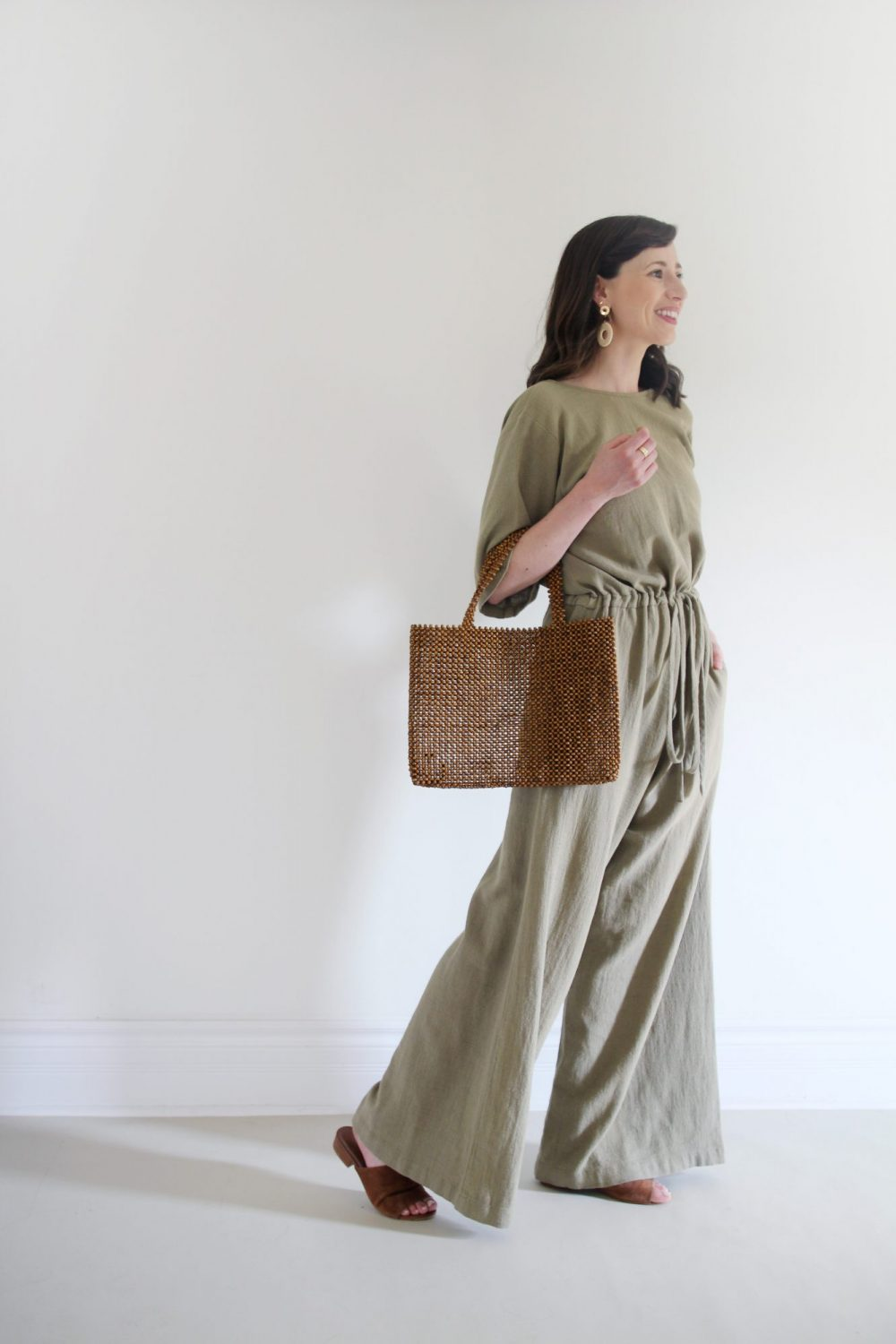 Style Bee - August Outfits - Look 3 - Duffy Jumpsuit + Suede Slides + Beaded Bag + Woven Earrings
